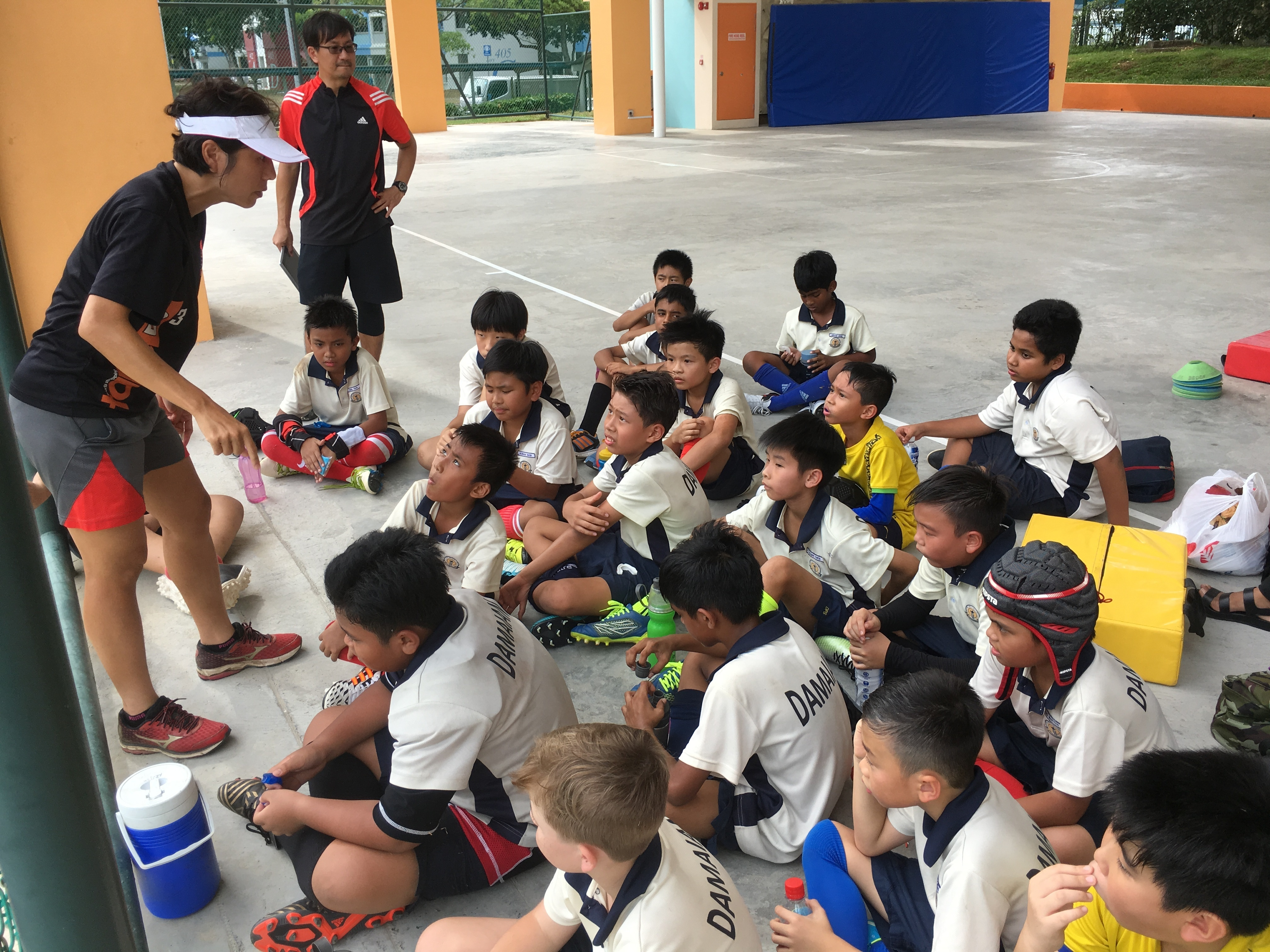 2018 Friendly with Casuarina Primary (Head Coach giving team talk).JPG